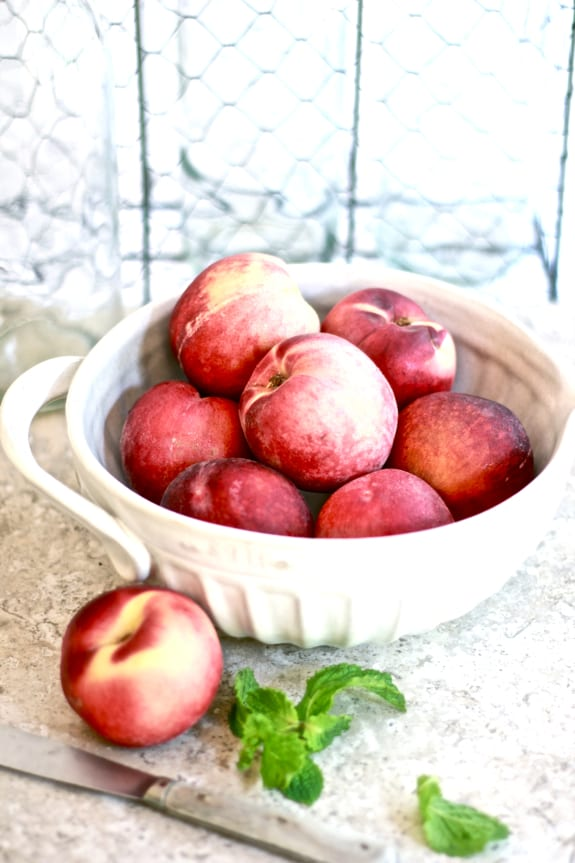 white peaches, ceramic measuring bowl