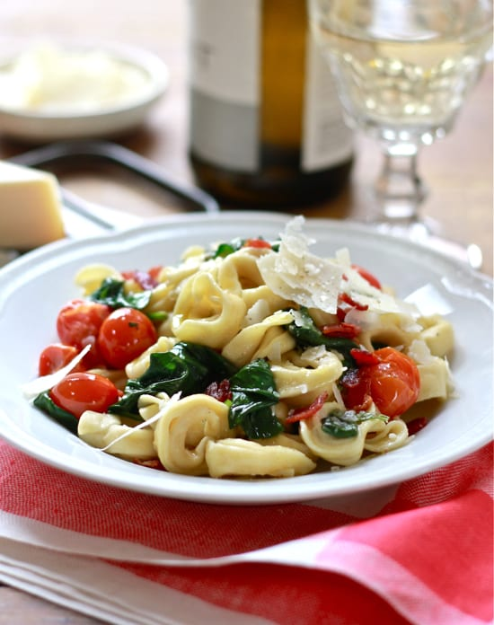 dinner tonight: tortellini with spinach and tomatoes