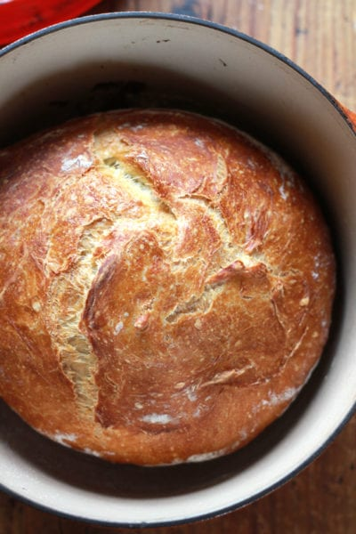 A loaf of no-knead artisan bread in a Dutch oven