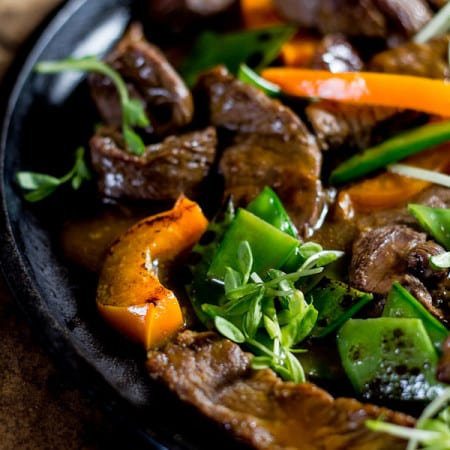 beef stir-fry with peppers + pea shoots