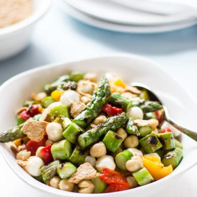 Chopped asparagus salad with smashed pita chips