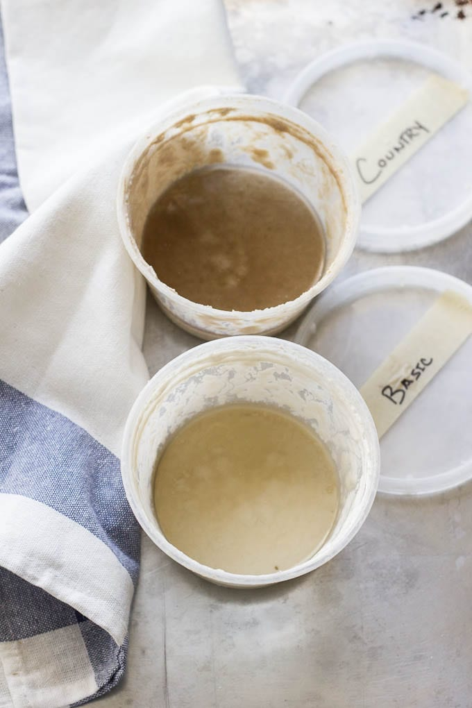 sourdough starter hooch dark gray liquid in a container