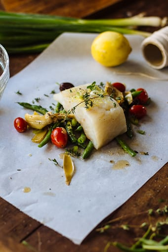 My husband served baked fish in parchment one year, and it was quite ...