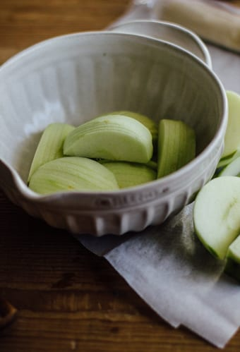 Thinly sliced Granny Smith apples in a bowl