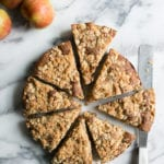 Fresh apple cake with a crumble topping cut into slices