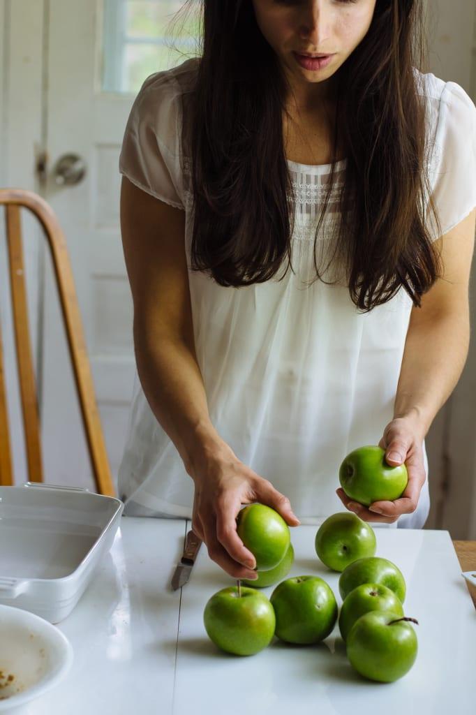 Emilie Raffa holding Granny Smith Apples