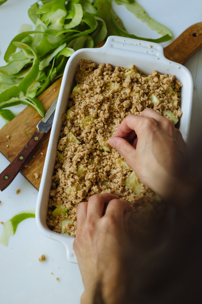 Assembled easy apple crumble dessert in a white baking dish
