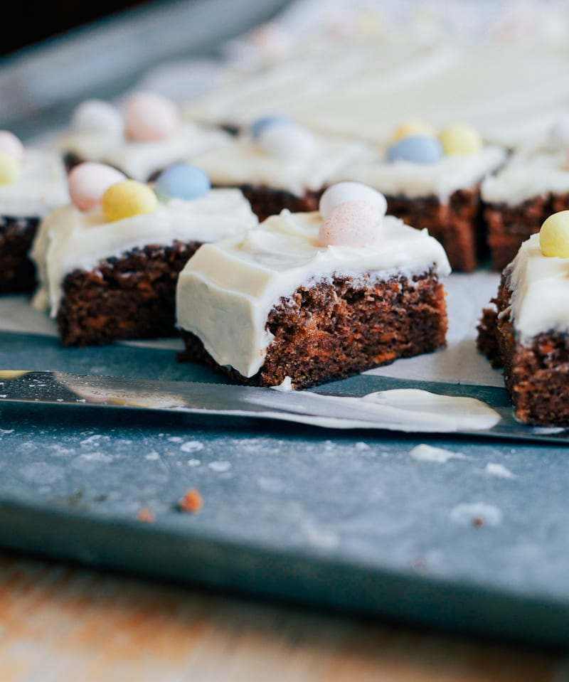 Sourdough carrot cake squares with pastel chocolate egg decorations
