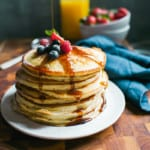 Stack of Fluffy Sourdough Pancakes with Maple Syrup | theclevercarrot.com