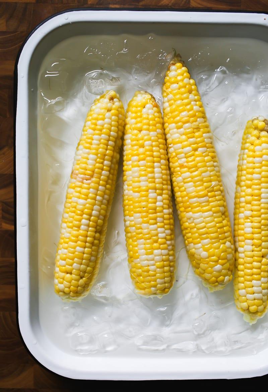 Corn on the cob in an ice bath.