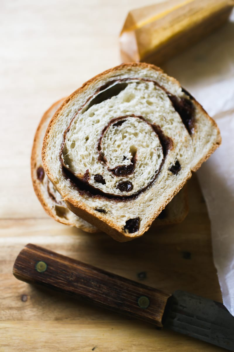 Close up of sourdough cinnamon raisin bread with a cinnamon-sugar swirl.