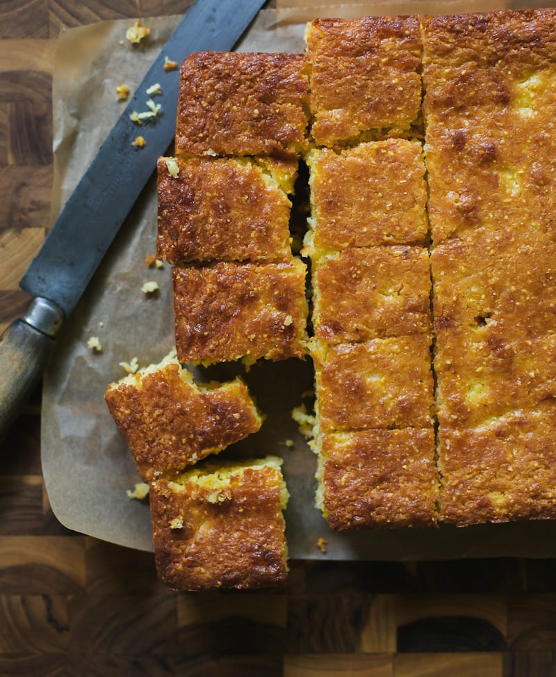 Thick-Cut Squares of Sourdough Cornbread on a Cutting Board