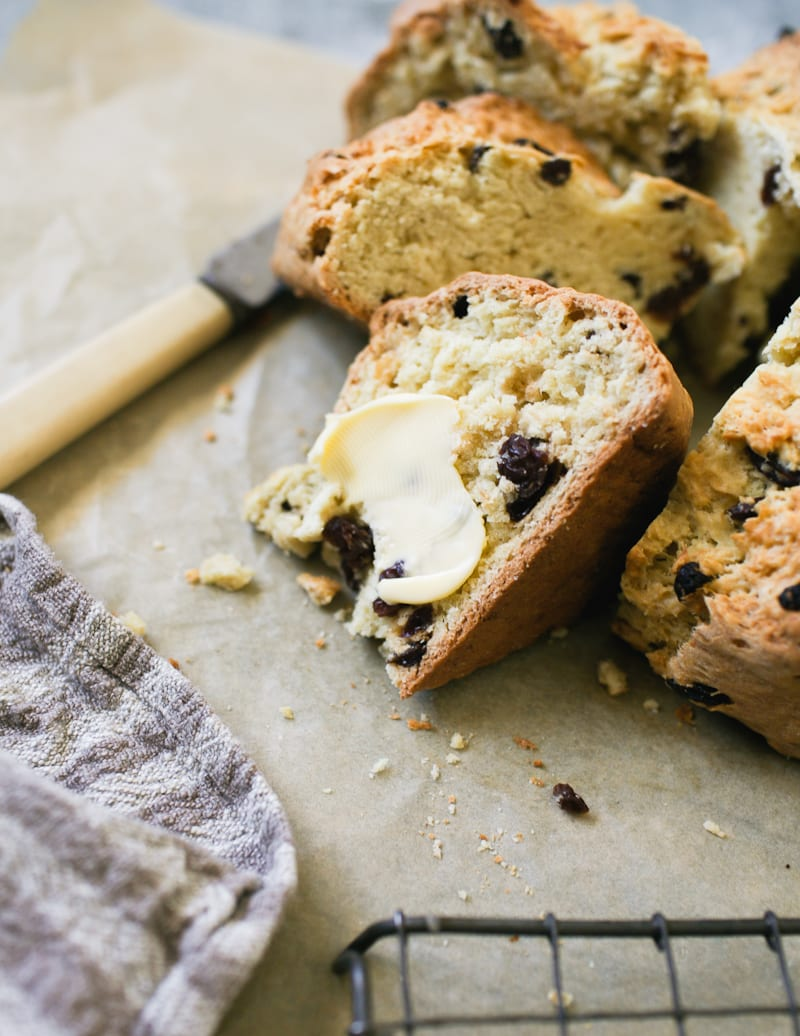 Wedge of sourdough Irish soda bread with soft butter