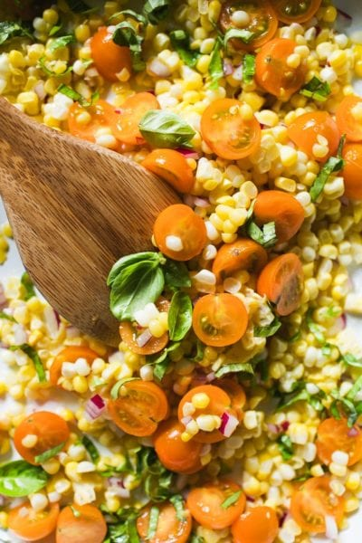 Fresh yellow corn, golden tomatoes, basil and red onion salad