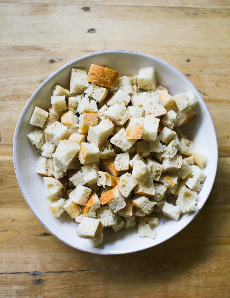 White bowl of cubed bread